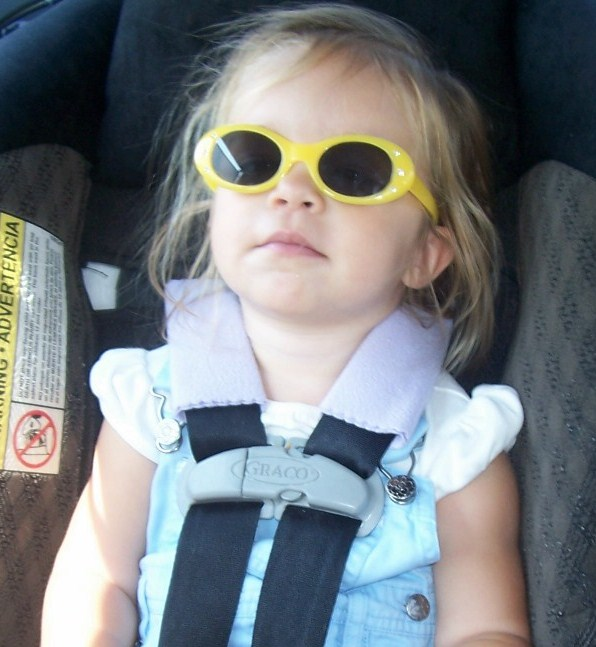 child in carseat w/ strap covers